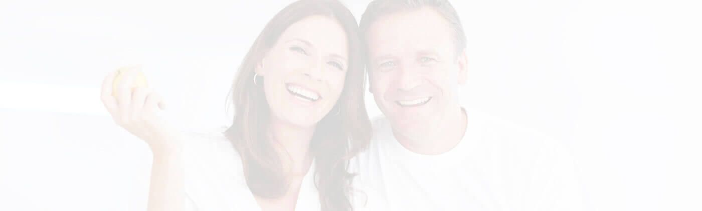 Fayetteville Restorative Dentistry Couple leaning on each other smiling