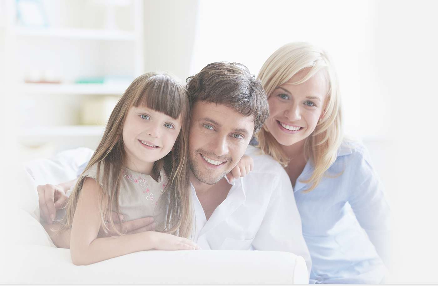 Family of three on couch smiling