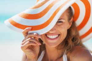 smiling woman with sun hat