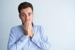 Concerned man hands over mouth should see Fayetteville emergency dentist