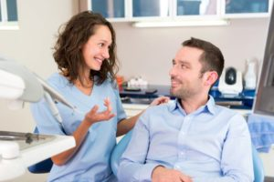cosmetic dentist talking with patient